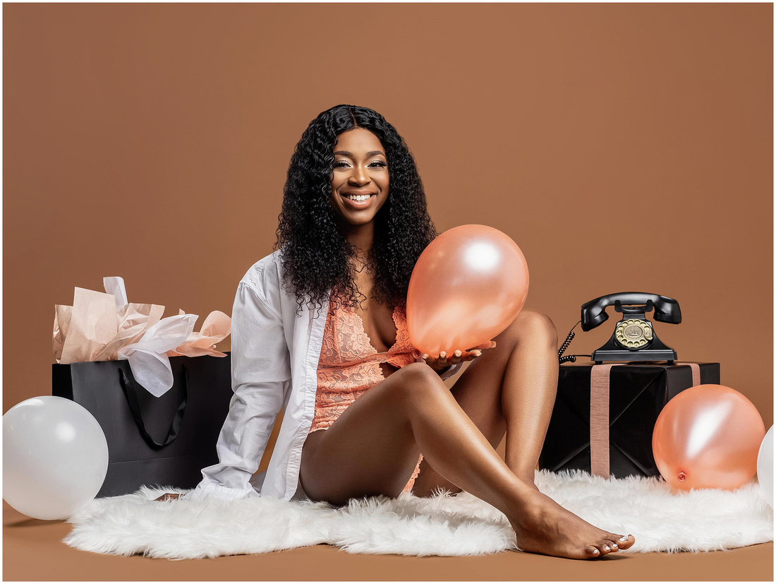 Ameerah's 21st Birthday Shoot in studio in Bridgeport, CT. Birthday photo shoot ideas for adults. Coral lingerie white and brown theme.