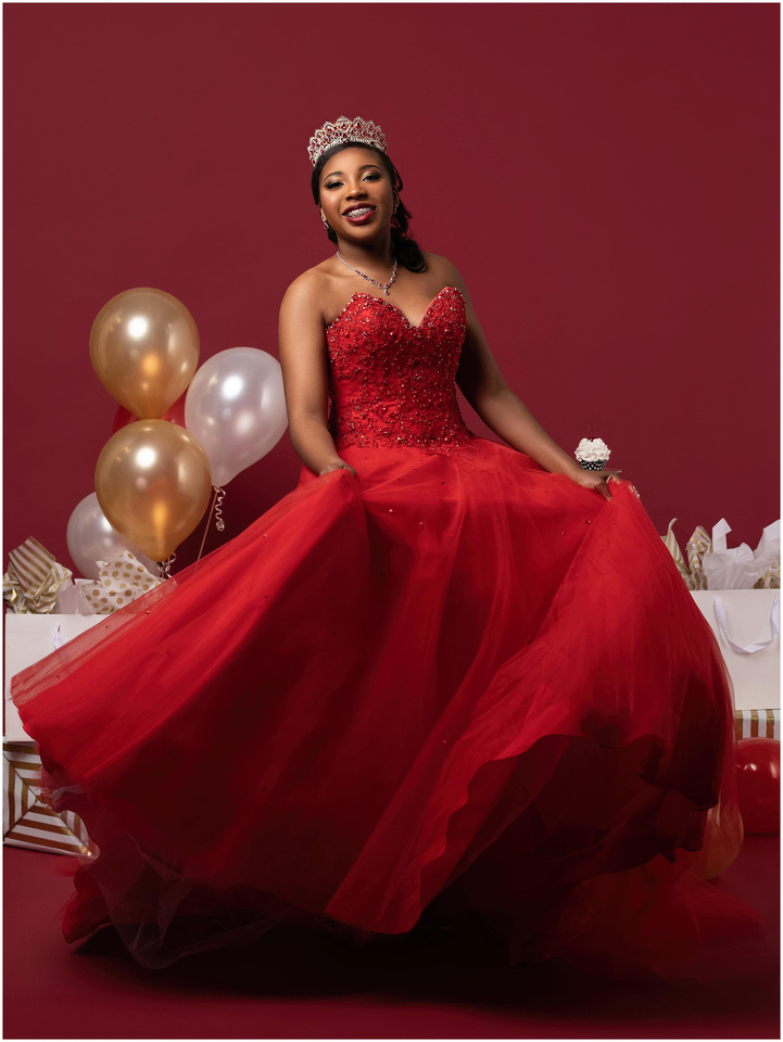 Justina's 16th Birthday Shoot in studio in Bridgeport, CT. Red white and gold theme. Big poofy red dress.